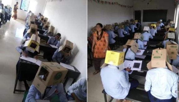 Scatole sulla testa durante l'esame per non far copiare